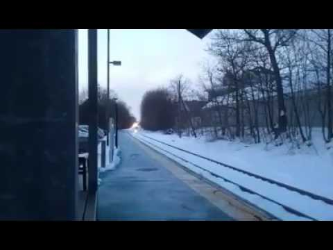 MBTA F40 PH pulling into Canton Center station in Canton Massachusetts.