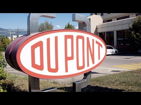 DuPont Tops Estimates While Cutting Costs Ahead of Dow Chemical Merger