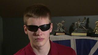 Defective helmet threatens young goalie's sight