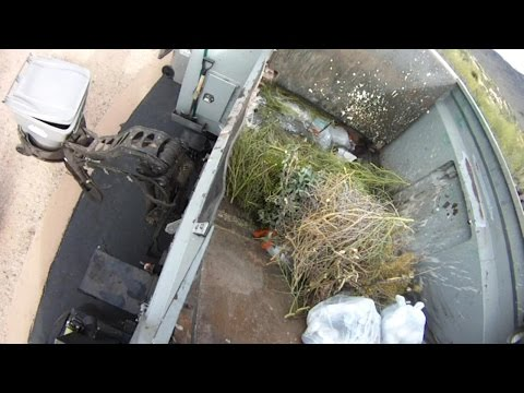 Curbside Hopper Video of a McNeilus AutoReach Garbage Truck