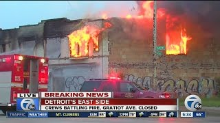 Crews battle suspected arson fire on Detroit