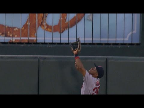 Young leaps to take away homer from Machado