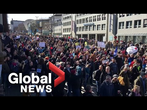 UK police scuffle with anti-lockdown protesters as thousands march in Germany, Austria