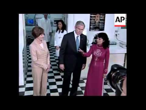 Bush visits stock exchange in Ho Chi Minh City; ADDS visit to Pasteur Institute and vox pops