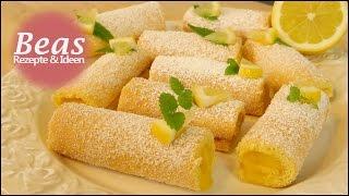 Zitronenrolle Rezept 🍋 Feine kleine Biskuitrollen mit Zitronencreme backen
