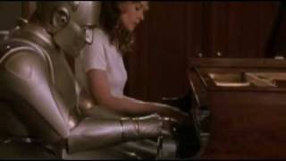 Bicentennial Man: Little Miss teaches Andrew how to play the piano.