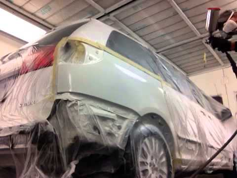 Spraying high solid auto clear coat