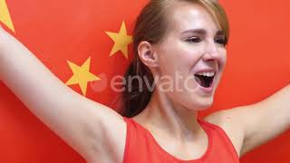 Chinese Young Woman Celebrates Holding the Flag of China | Stock Footage - Videohive