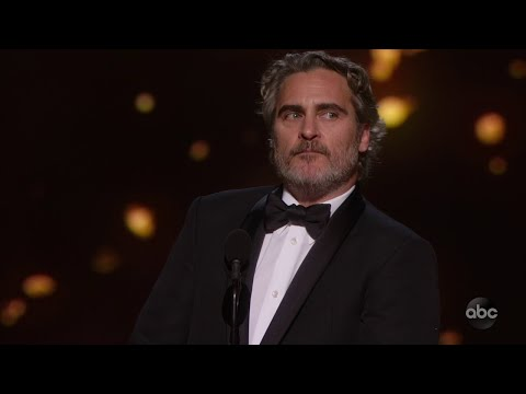 Joaquin Phoenix Accepts The Oscar For Lead Actor