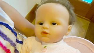 Katy pretendplay with baby doll