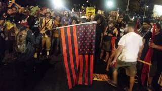 American flag set on fire outside Wells Fargo Centre at Philadelphia DNC- 07.27.16