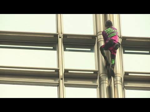 Tanner and Drew - 'French Spiderman' climbs Hong Kong building