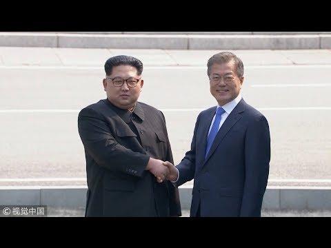 Moon, Kim shake hands at Panmunjom