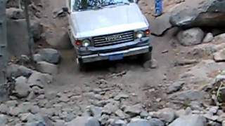 Land Cruiser Fj60 Crossing A Dry Creek Bed In Boards Crossing