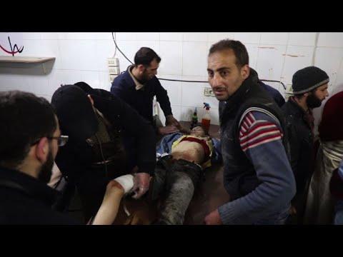 Merkel calls for end to 'massacre' in Syria amid fresh strikes