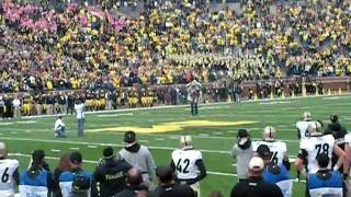 Guy wearing Jet Pack flys into Michigan stadium