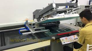 Screen printing machine with auto unloading system