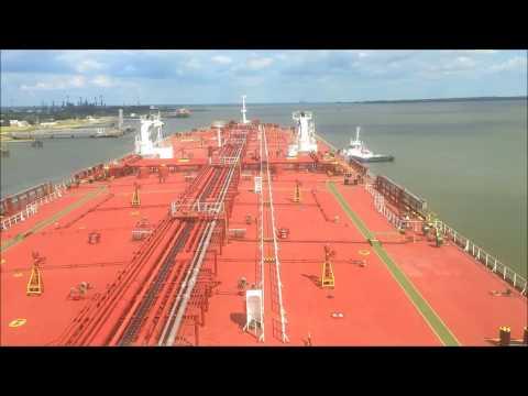 Oil tanker vessel M T Dolviken unberthing from Donges,France passing under St. Nazaire bridge.