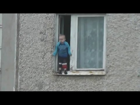 Nothing to see here: Toddler hangs from 8th floor window in Russia