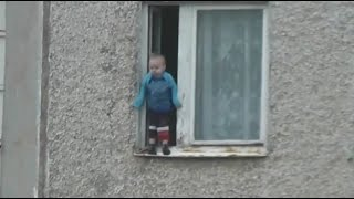 Nothing to see here: Toddler hangs from 8th fl window in Russia, safe