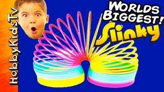 Worlds Biggest SLINKY Surprise Egg! POOL Party + Toys, Puppy Robot Poop HobbyKidsTV