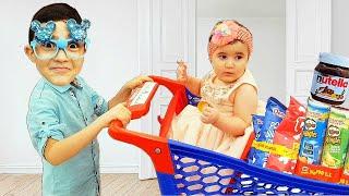 Celina And Hasouna At Super Market  - سيلينا وحسونة في محل الاطفال