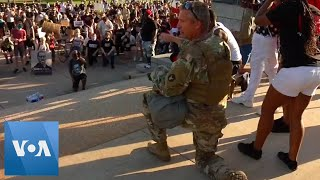 Minnesota Guard Soldier Hugs Protesters at Capitol in St. Paul