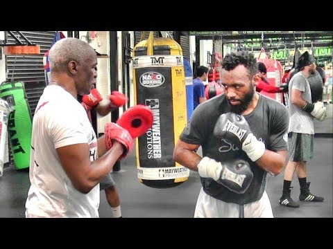 Austin Trout gets a boxing lesson from Floyd Mayweather Sr