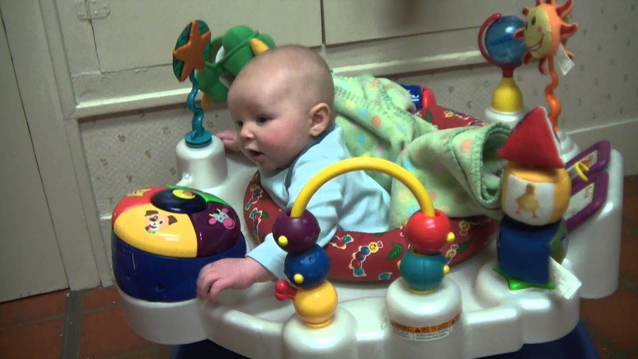 3 month old baby boy laughing or is it crying at jumping sister