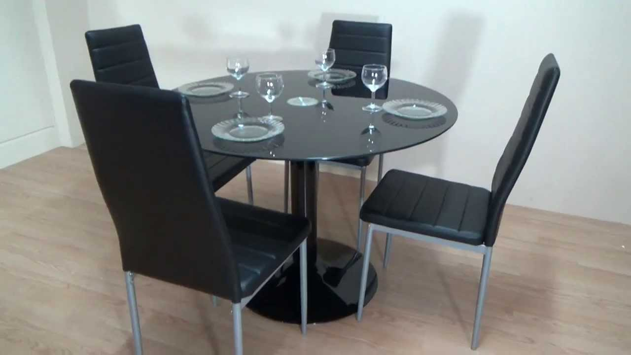 Descatalogado pack mesa redonda de cristal negro 4 for Decorar una mesa de comedor de cristal