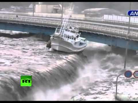 New dramatic video  Tsunami wave spills over seawall, smashes boats, cars