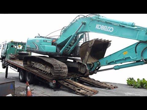 Fuso Self Loader Truck Delivering Excavator Kobelco SK200