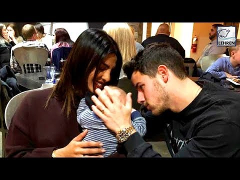 Priyanka Chopra And Nick Jonas Cuddling A Baby Is Making Us Super Emotional | LehrenTV