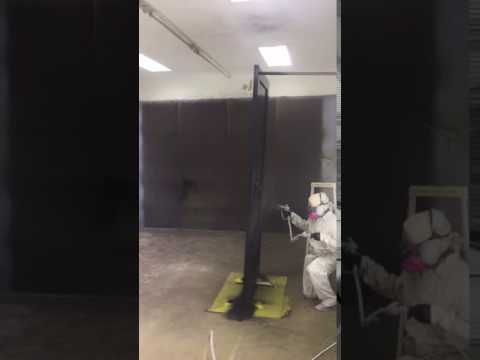 spraying a front door with highgloss paint in portland or