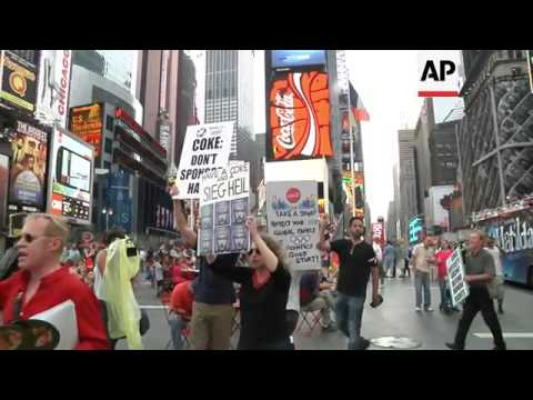 Coke dumped in Times Square to protest Coca-Cola's sponsorship of 2014 Winter Olympic in Russia