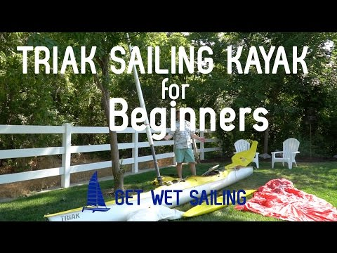Triak Sailing Kayak for Beginners: http://GetWetSailing.com/triak-sailing-kayak-intro-video/ My new-to-me, used Triak Sailing Kayak Intro Video walks through the entire boat, everything that came with my 2010 Triak. This is the first in a series about repairing, upgrading and sailing my Triak.