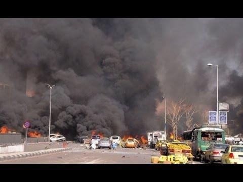 Damascus car bombs seen on live TV news broadcast