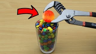 EXPERIMENT Glowing 1000 degree METAL BALL vs M&M