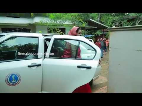 Malappuram Collector demonstrating post-flood well purificat