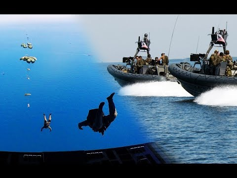 U.S. Navy SPECIAL BOAT TEAM parachute into the sea with assault boats from C-17