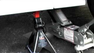 How To Raise or Lift Your Car onto Jack Stands--AutoHow.TV