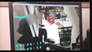 Santa Fe Police search for 2 store robbery suspects