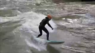 Endless surfing on a natural river wave in Austria