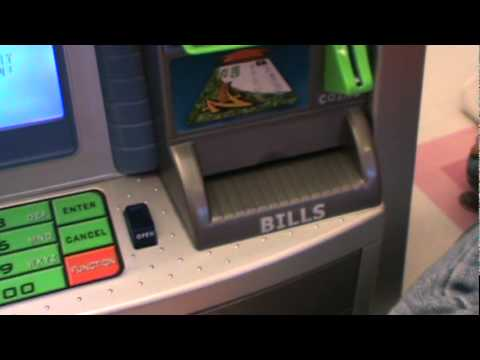 ZIllions Savings Goal ATM Bank in action
