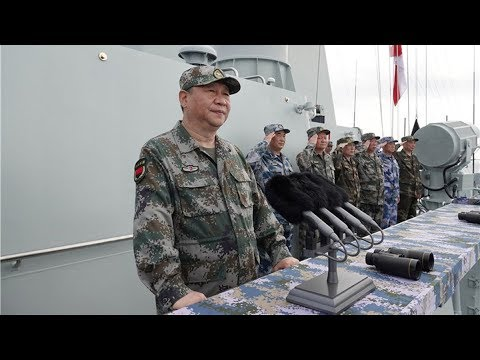 Xi Jinping inspects massive navy parade in South China Sea