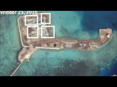 South China Sea: Satellite photos 'show weapons' built on islands