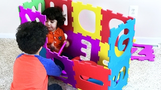 Making big box with ABC squishy puzzle. Kids playing inside a big alphabet box. Let