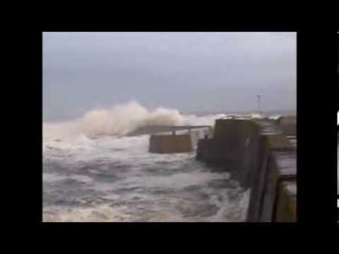 St Abbs Harbour, Scotland, being pounded by big waves and High Tide. 19th January 2014