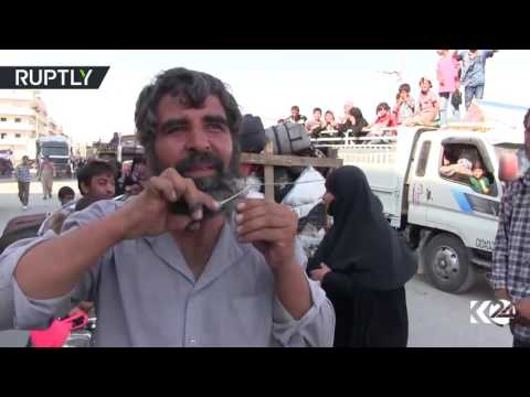 Women burn burqas, men cut beards: Watch Syrians celebrate independence from ISIS