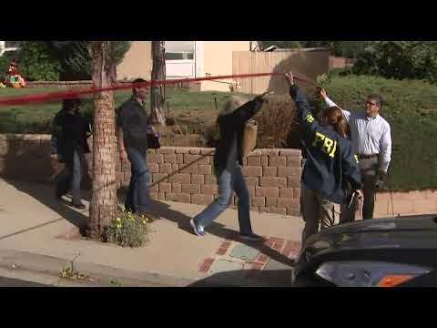 Investigators outside bar shooting suspects home